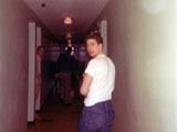 Jim Neilsen in the barracks hallway. Mosley on the left in the doorway.