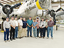 The guys pose in front of the B-17 on display (L-R): Chuck Schabel, Craig Meyers, Sam Bothern, Paul Baker, Museum volunteer, Bill Woodward, Steve Bisel, Steve Carr, Bob Roberts & Jim Jenkins