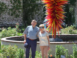 Bob and Joan pose by the Chihuly sculpture