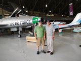 Wayne Miller and Bill Woodward pose in front of the F-100