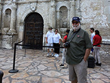 Steve Bisel poses in front of the iconic Alamo