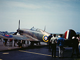 "Hawker Hurricane @ 3/6/68 Wetherfield Airshow. Note that this aircraft was being used at the time in the filming of the movie ""Battle of Britian"" which took place overhead very near to Wethersfield. When they were filming air to air battles, you could see the contrails overhead."